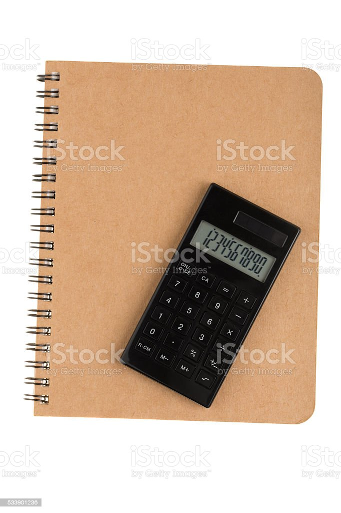 Calculator on book with spiral wire front cover stock photo