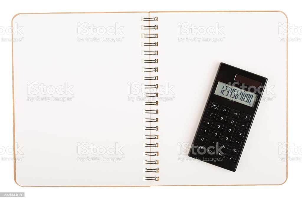 Calculator on book with spiral wire stock photo