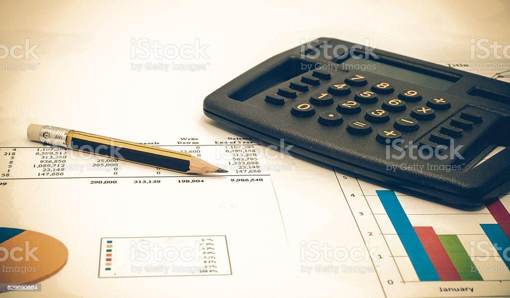 calculator on business chart stock photo