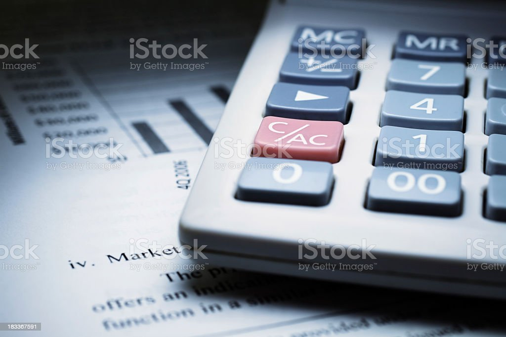 Calculator on chart of financial analysis and graphs royalty-free stock photo