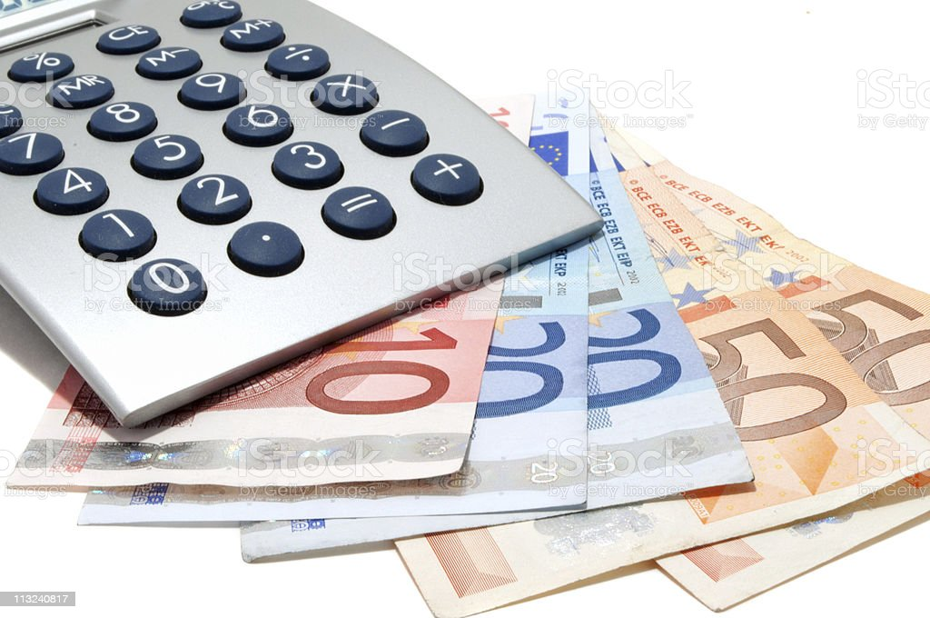 Calculator on the euro banknotes royalty-free stock photo