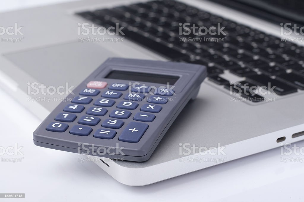 calculator on the laptop keyboard stock photo