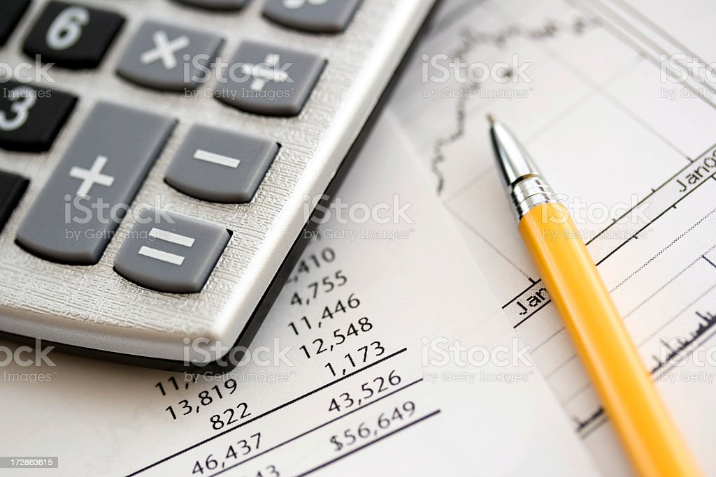 A calculator on top of some financial data royalty-free stock photo