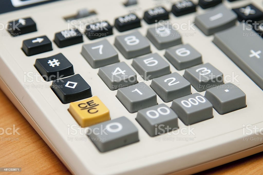 Calculator on wood texture background royalty-free stock photo