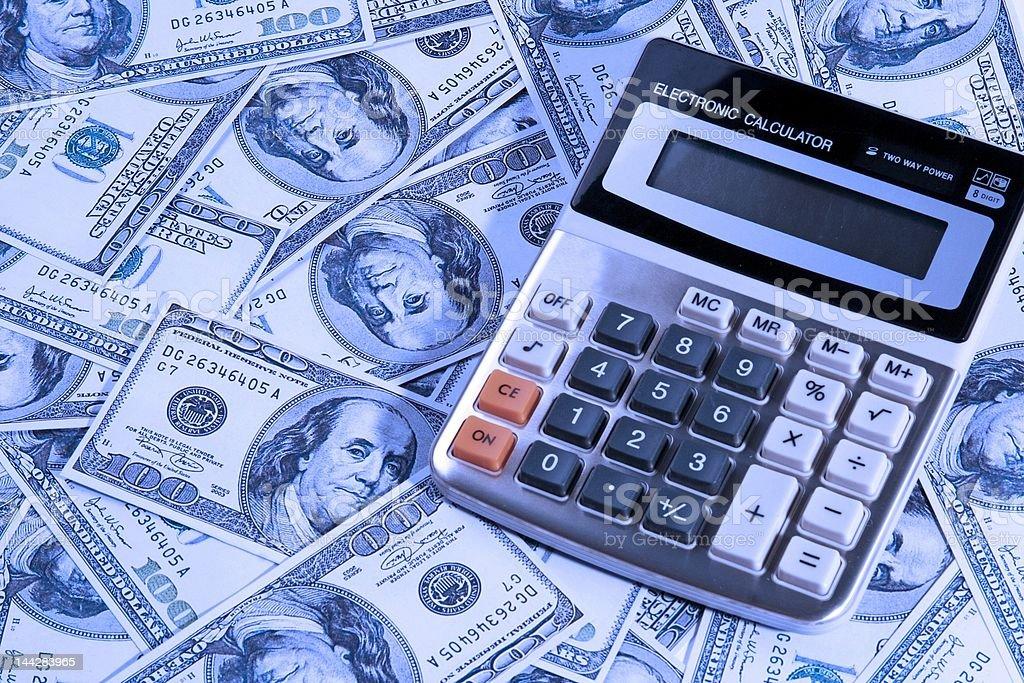 Calculator Over Money royalty-free stock photo