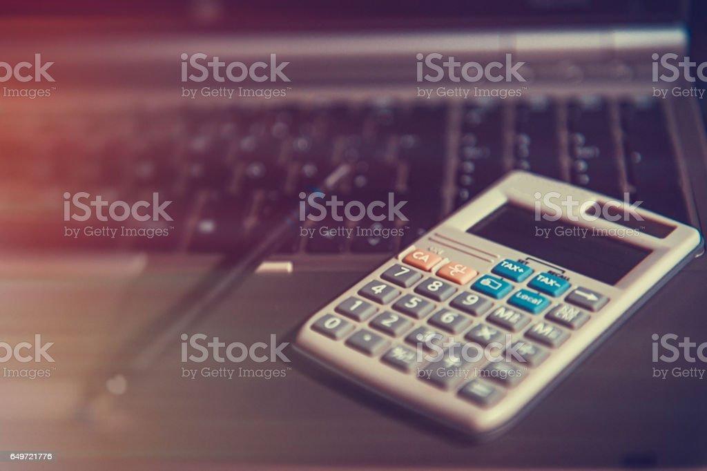 Calculator pen and calendar in office stock photo