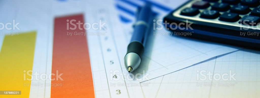 calculator, pen and financial papers stock photo