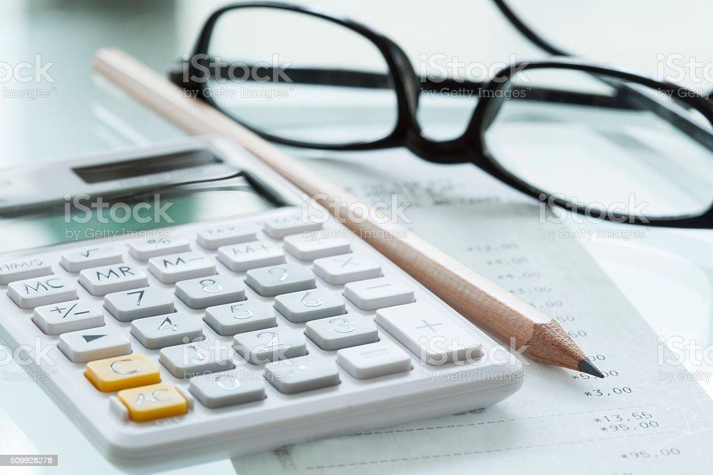 Calculator pen and glasses stock photo