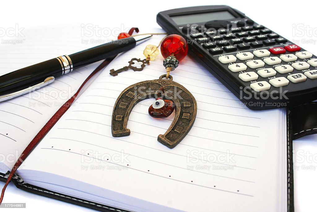 Calculator, pen and notebook royalty-free stock photo