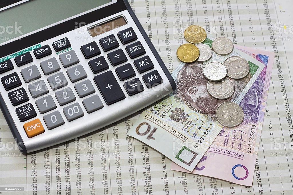 calculator, polish money and newspaper royalty-free stock photo