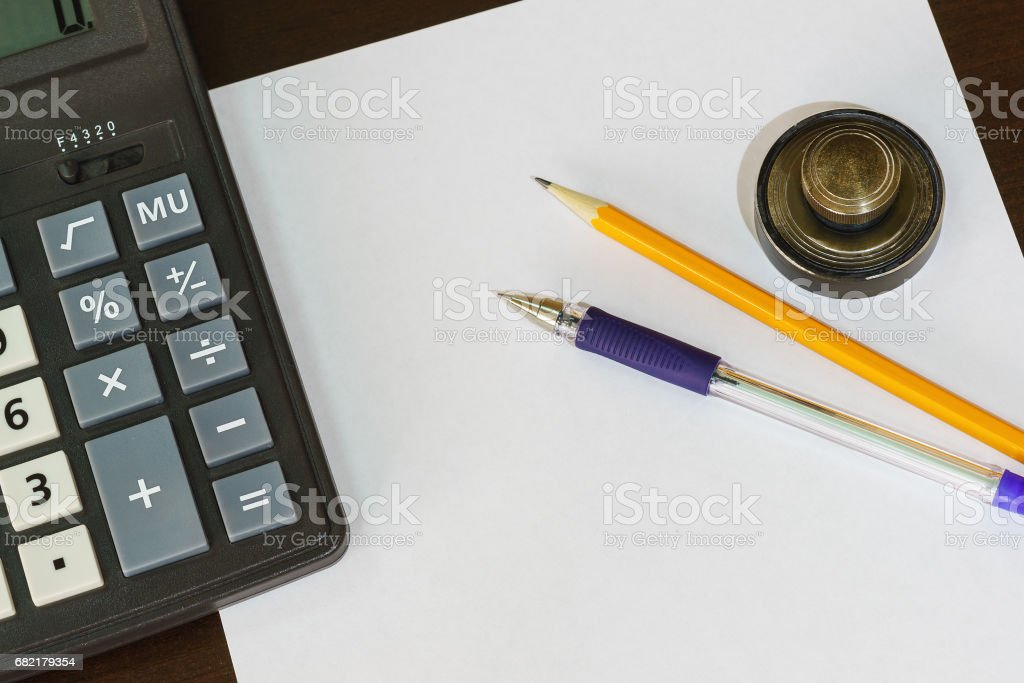 Calculator, print, pen and pencil lying on a blank sheet of paper. stock photo