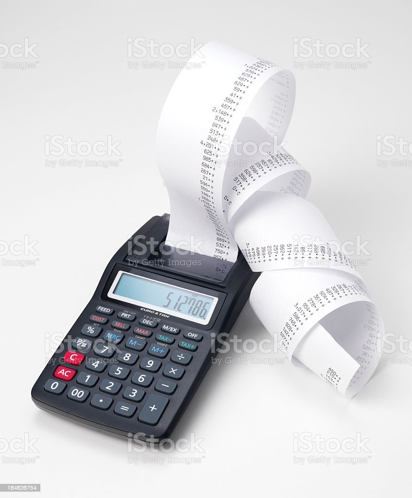 Calculator printing figures on rolled paper stock photo
