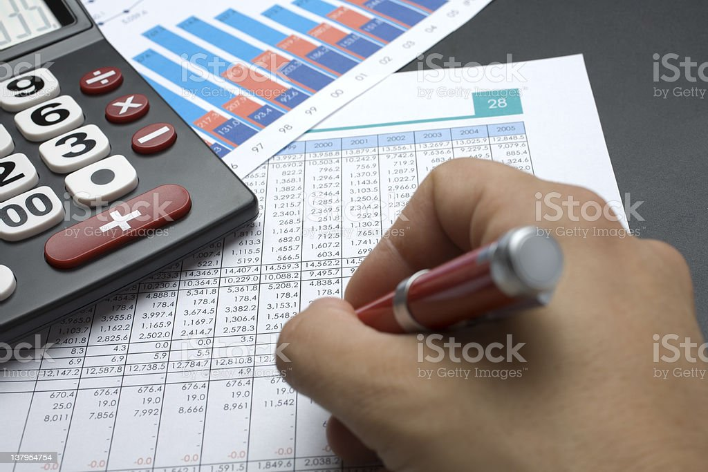 Calculator, spreadsheet and hand writing stock photo
