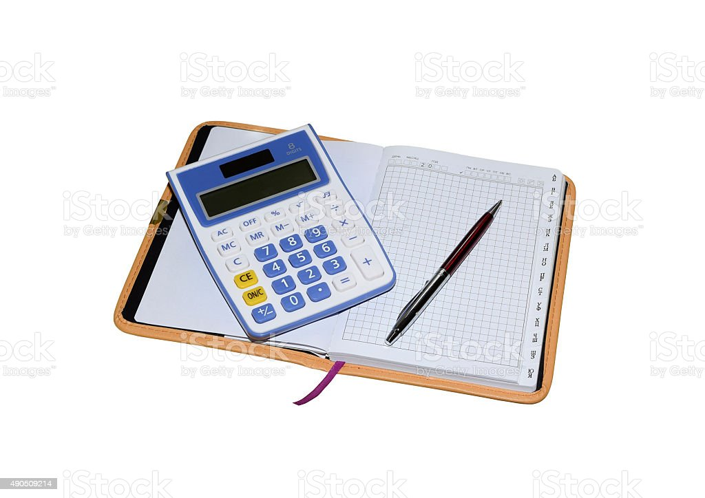 Calculator white blue with red pen on the Notepad. stock photo