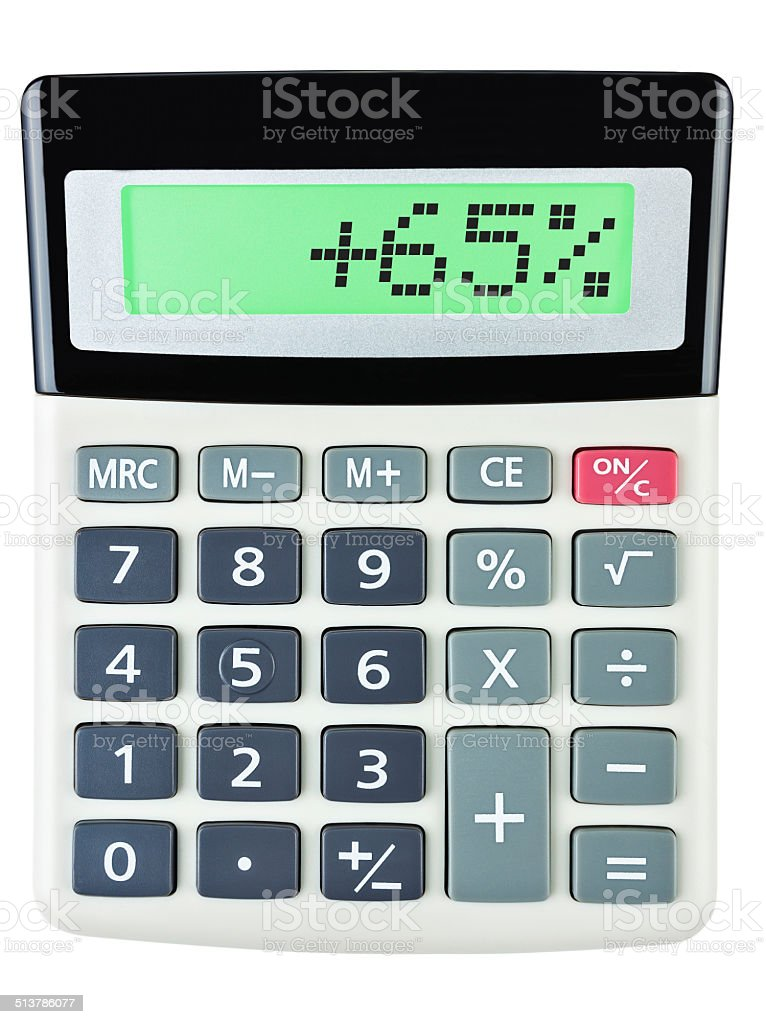 Calculator with +65% on display on white background stock photo