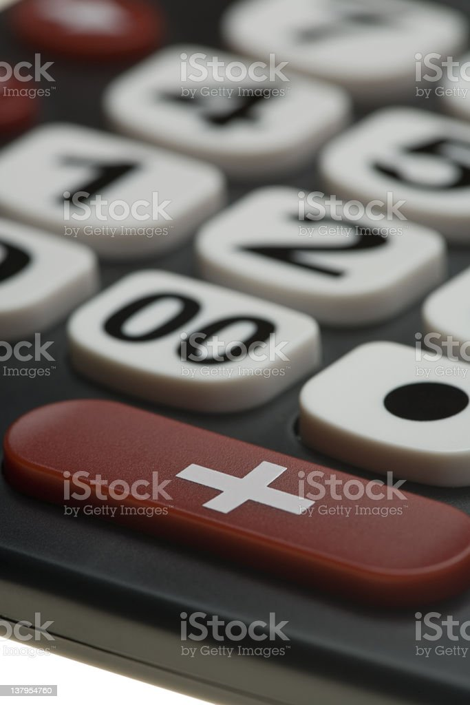 Calculator with big numbers and + sign stock photo