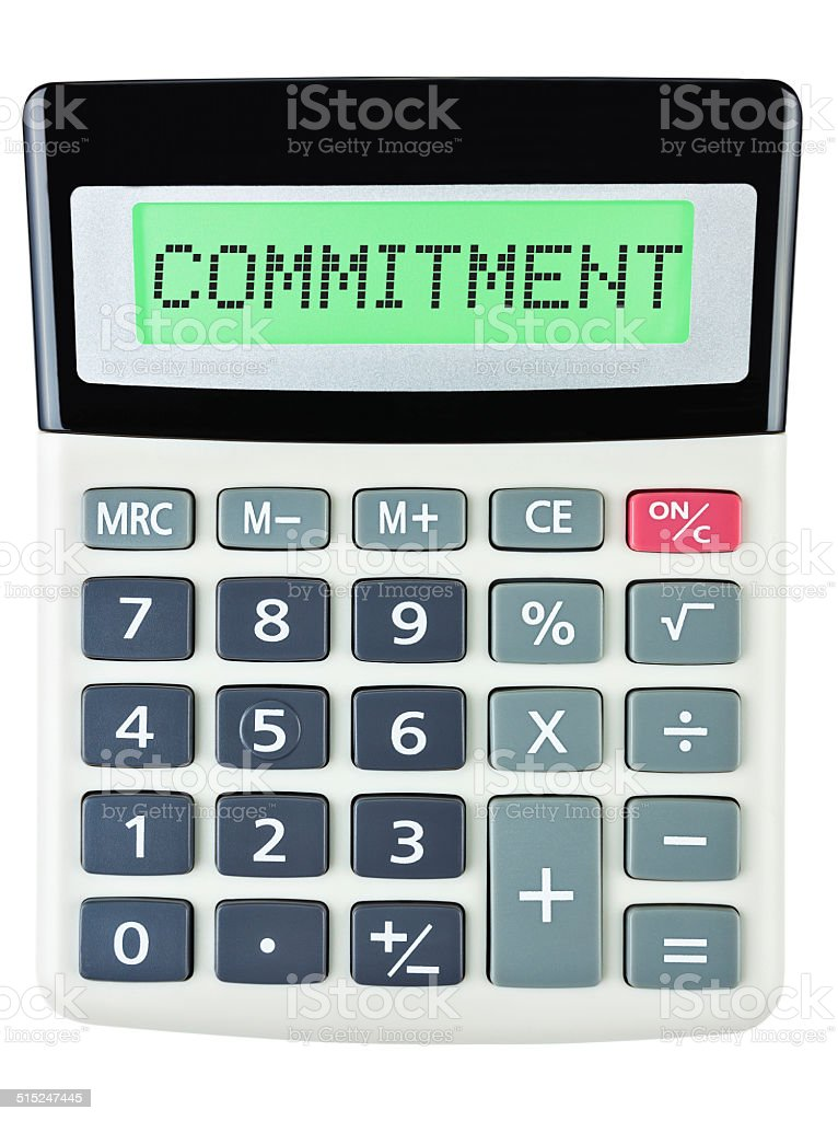 Calculator with COMMITMENT on display isolated on white stock photo
