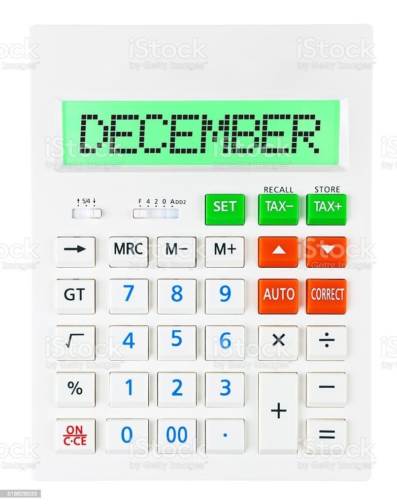 Calculator with DECEMBER on display isolated on white background stock photo