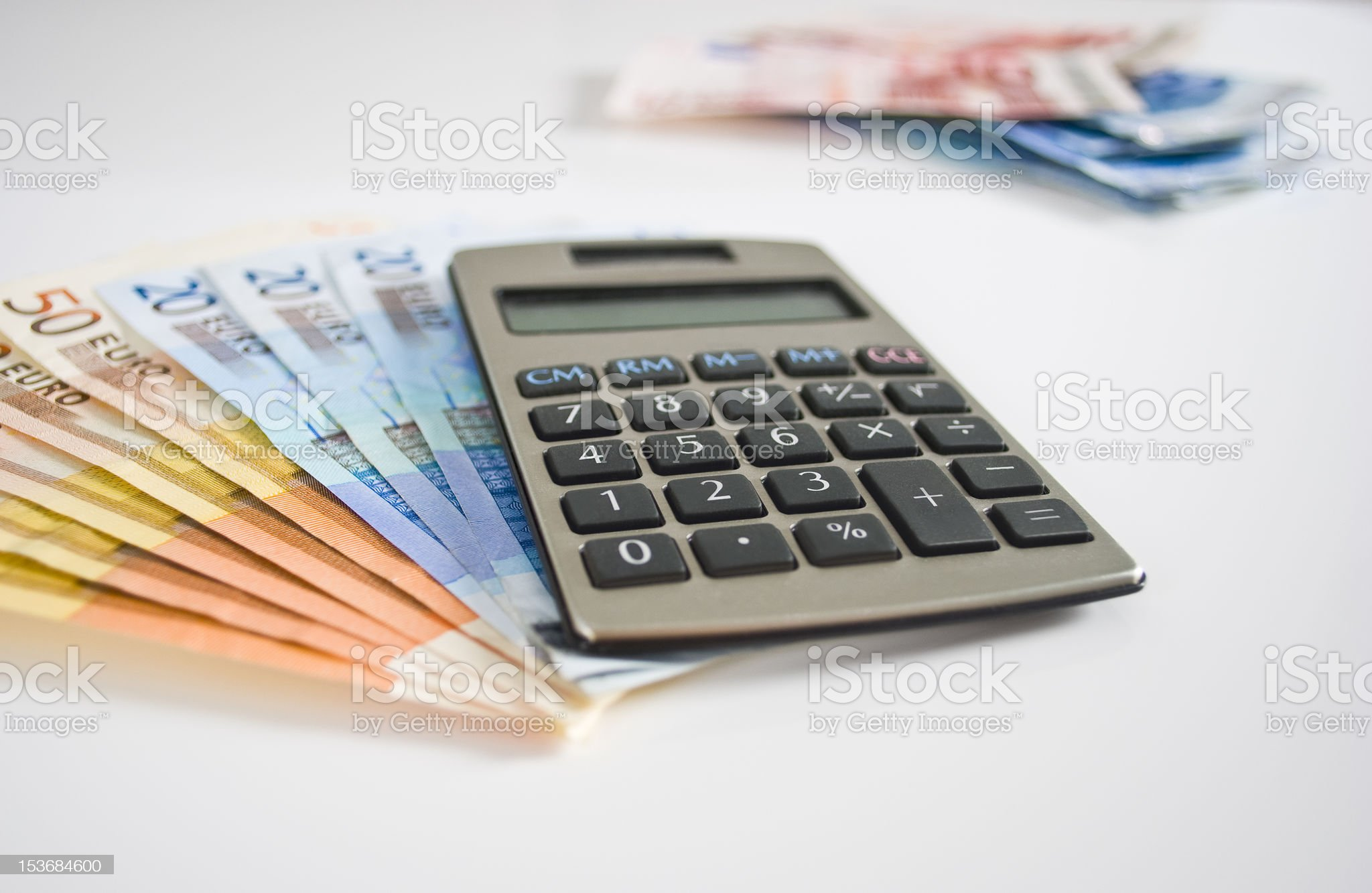 Calculator with Euro bank notes royalty-free stock photo