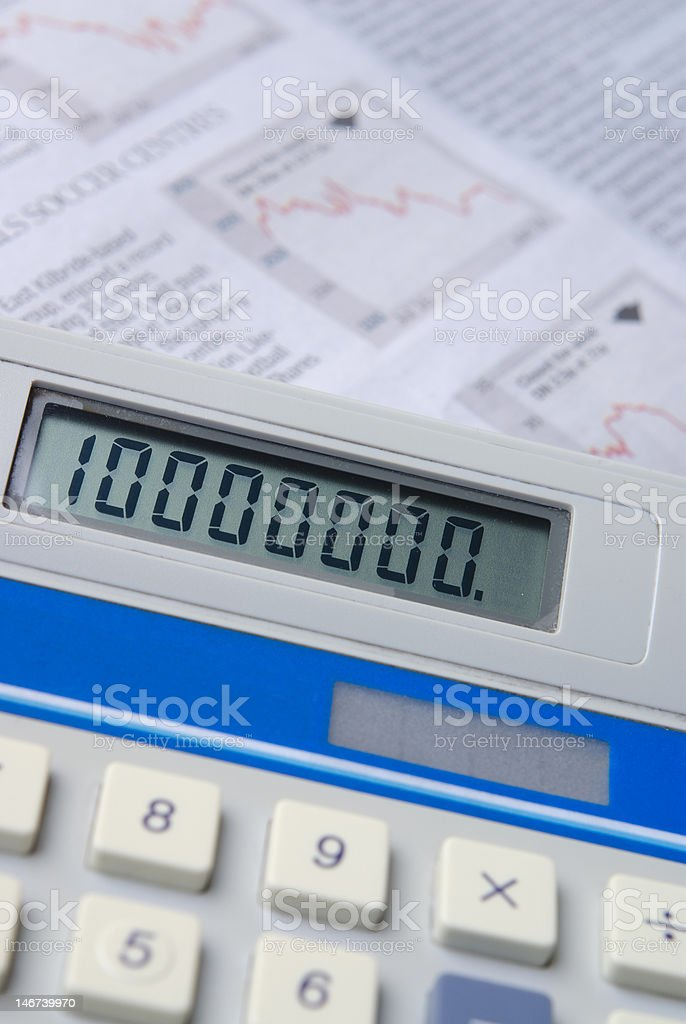 Calculator with financial newspaper royalty-free stock photo