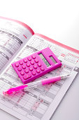 Calculator with home finance book