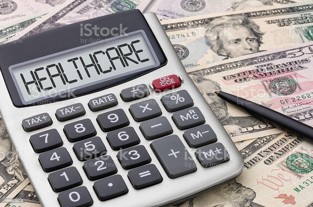 Calculator with money - Healthcare stock photo