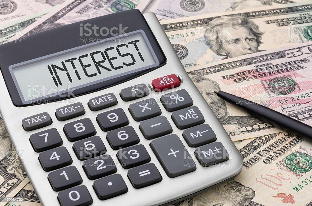 Calculator with money - Interest stock photo