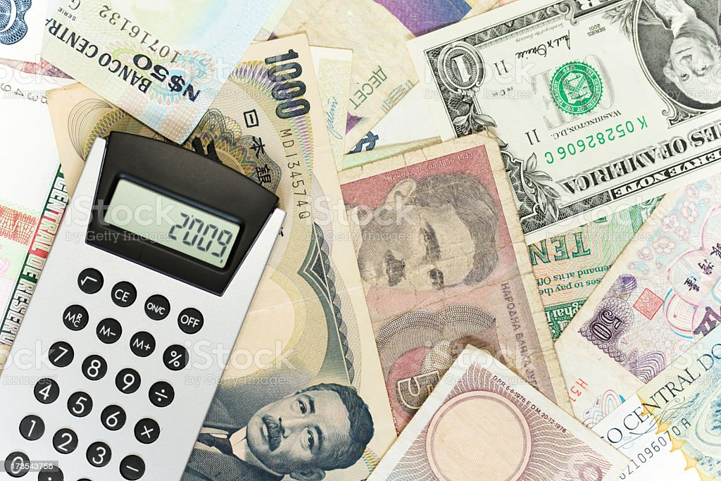 Calculator with year 2009 on the display. Currency in background. royalty-free stock photo