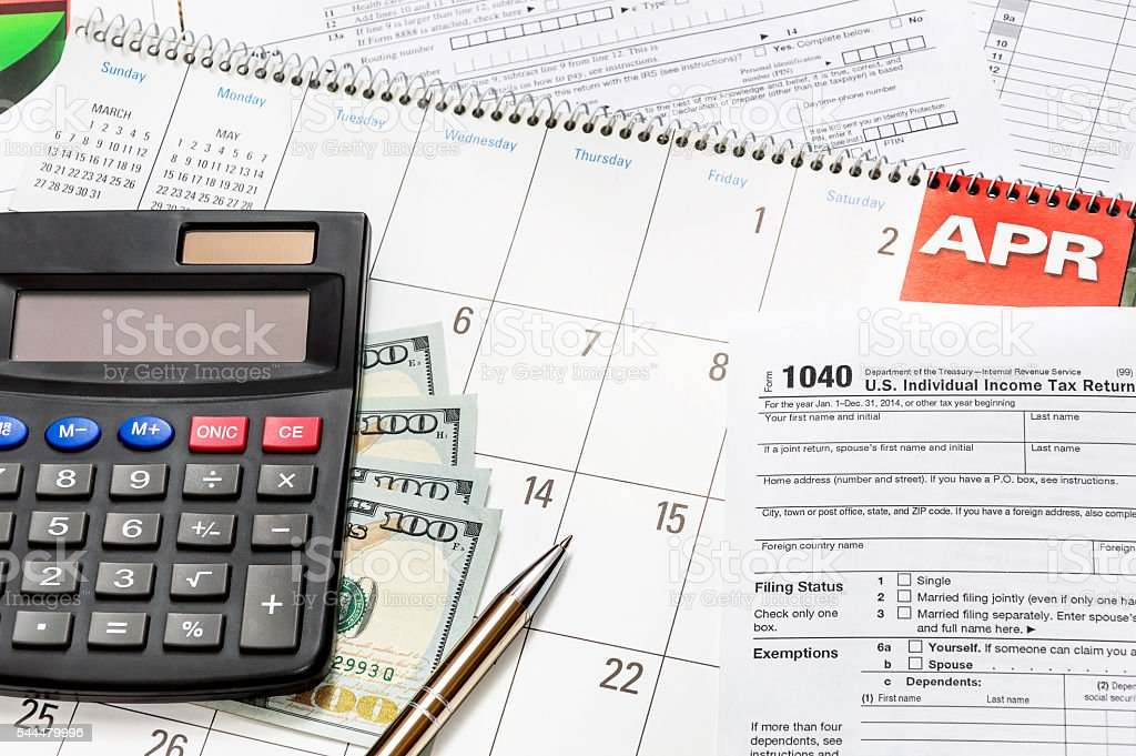Calculator wth tax form on the calendar stock photo