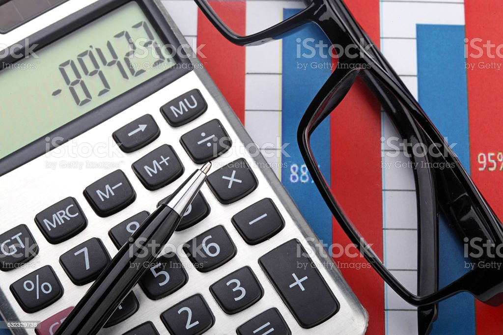 calculator,concept,eyeglasses,economics,finance. stock photo