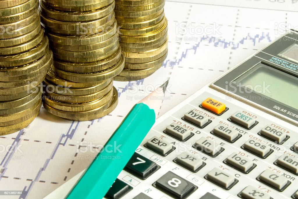 calculator,pencil and coins on graffica the Dow Jones stock photo