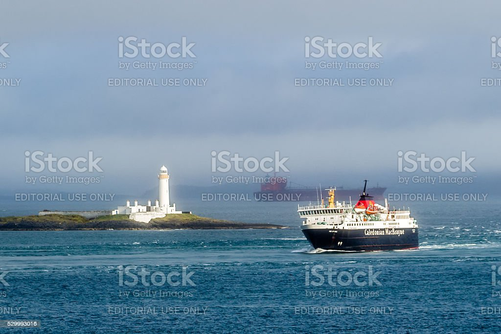 Caledonian Macbrayne ferry passing by Lismore lighthouse stock photo