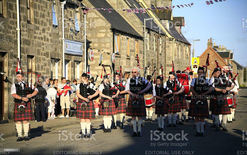 Caledonian Pipe Band perform at Brora village, Sutherland, Scotland stock photo