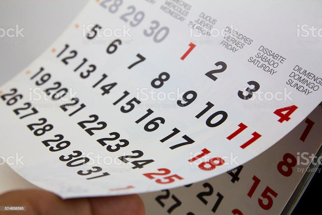 Calendar close-up with human finger stock photo