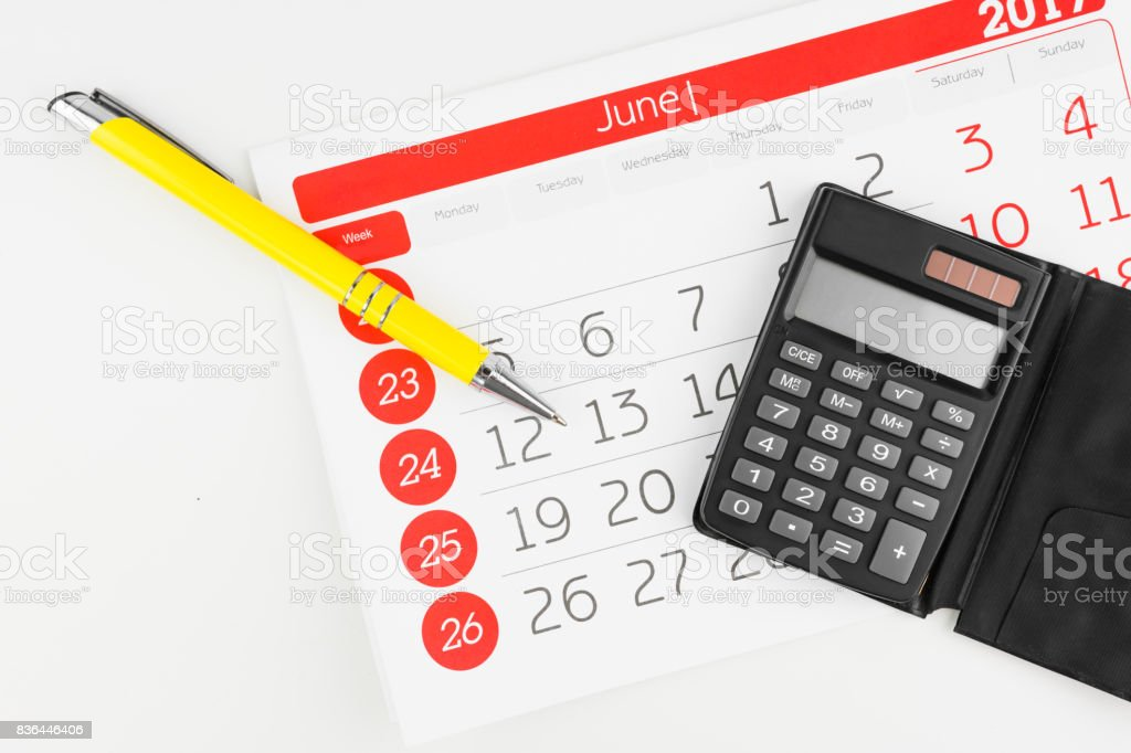 Calendar Days With Calculator And Pen Aside stock photo