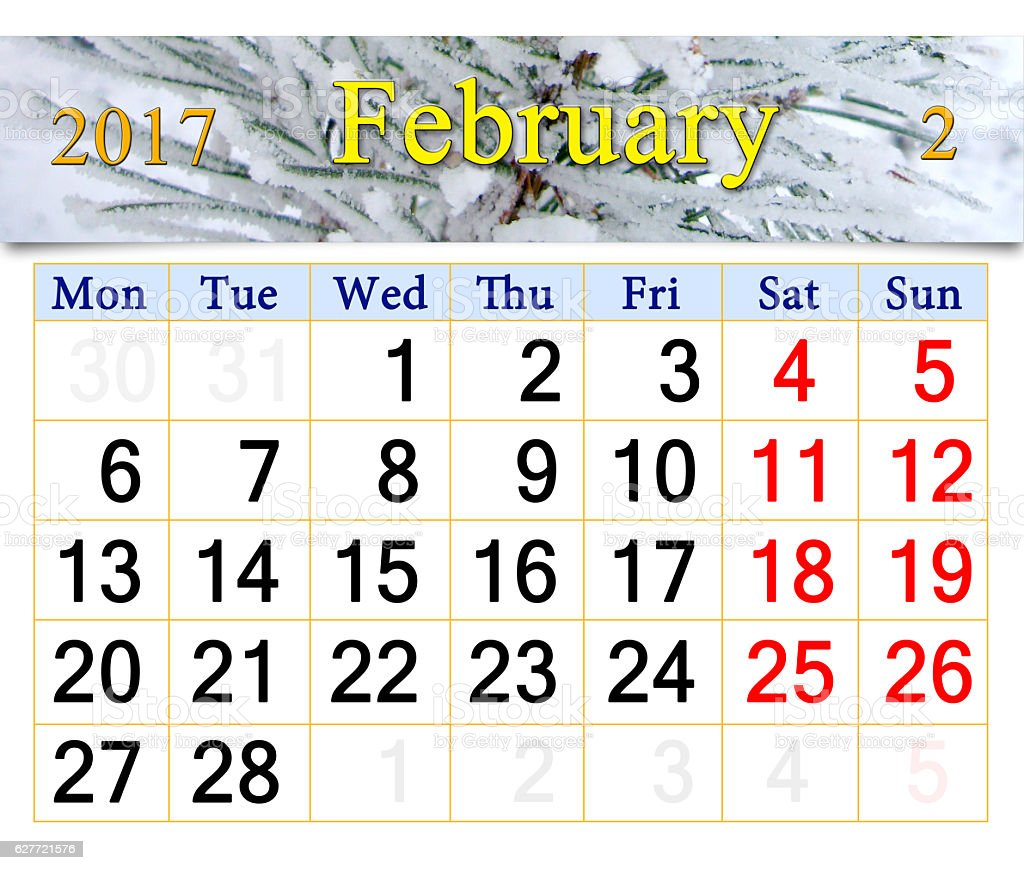 calendar for February 2017 with winter pines stock photo