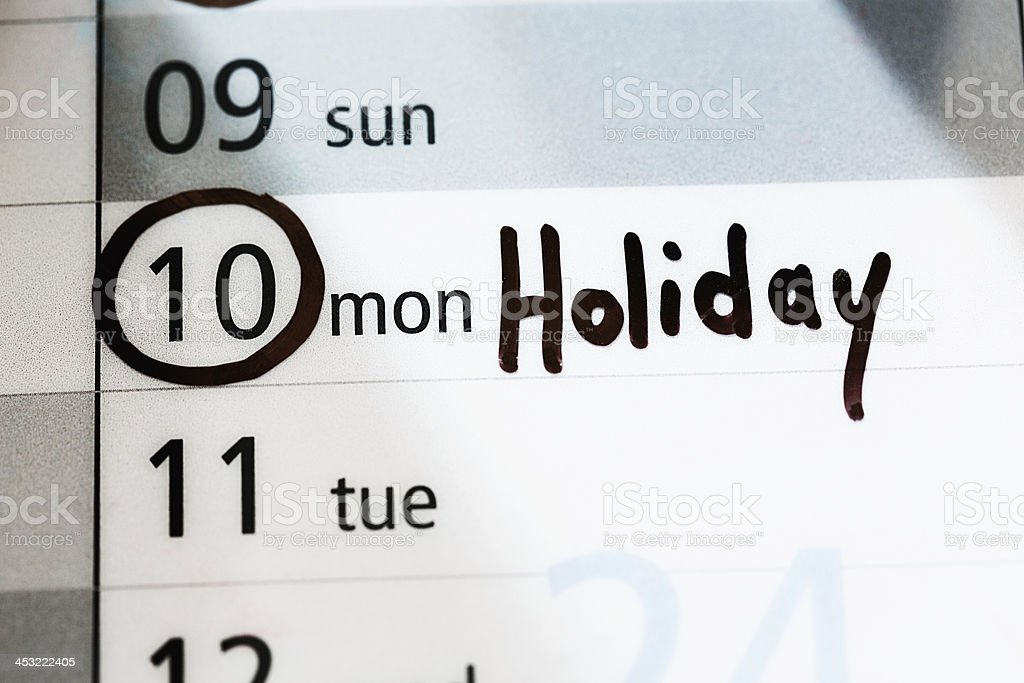 Calendar has Holiday marked for Monday - long weekend royalty-free stock photo