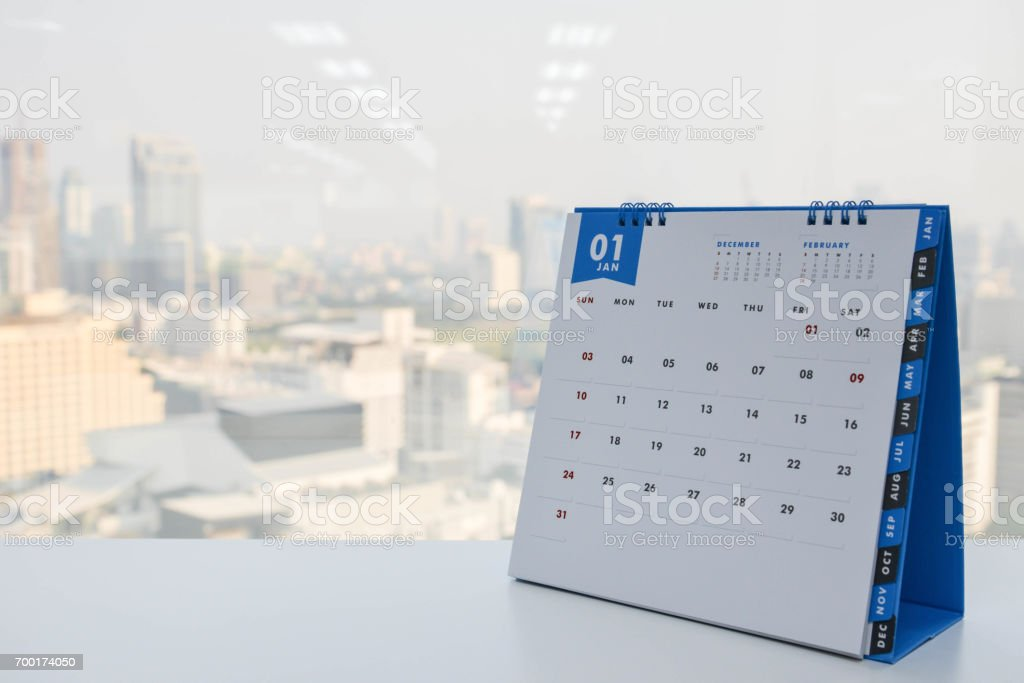 Calendar of January on the white table with city view background stock photo