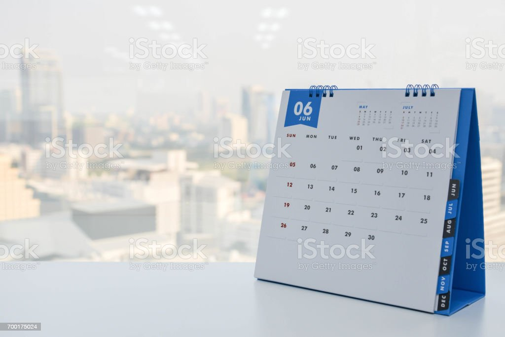 Calendar of June on the white table with city view background stock photo