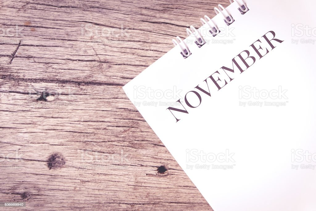 Calendar page on wood texture pink tone. stock photo