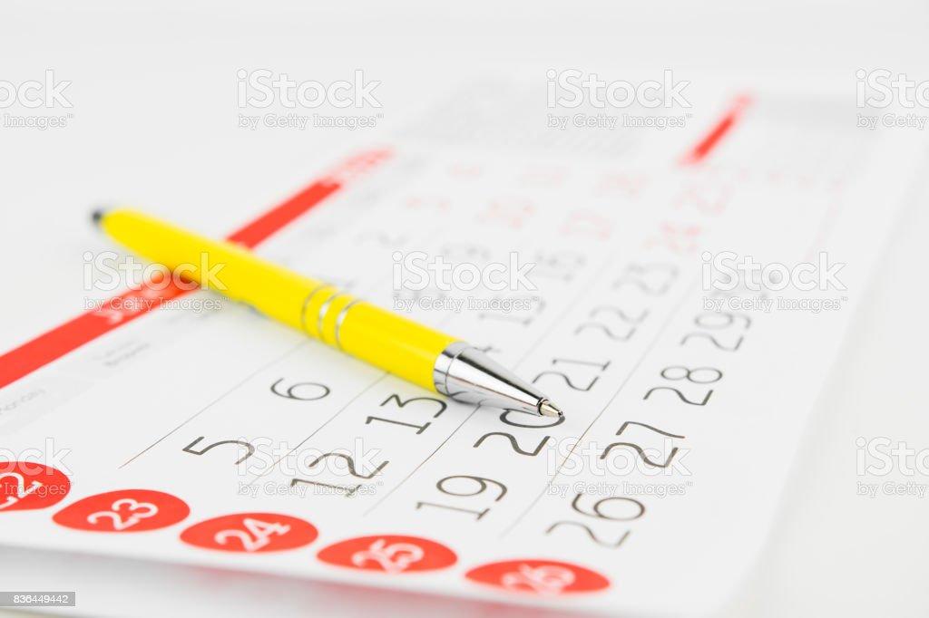 Calendar Sheet And Pen stock photo