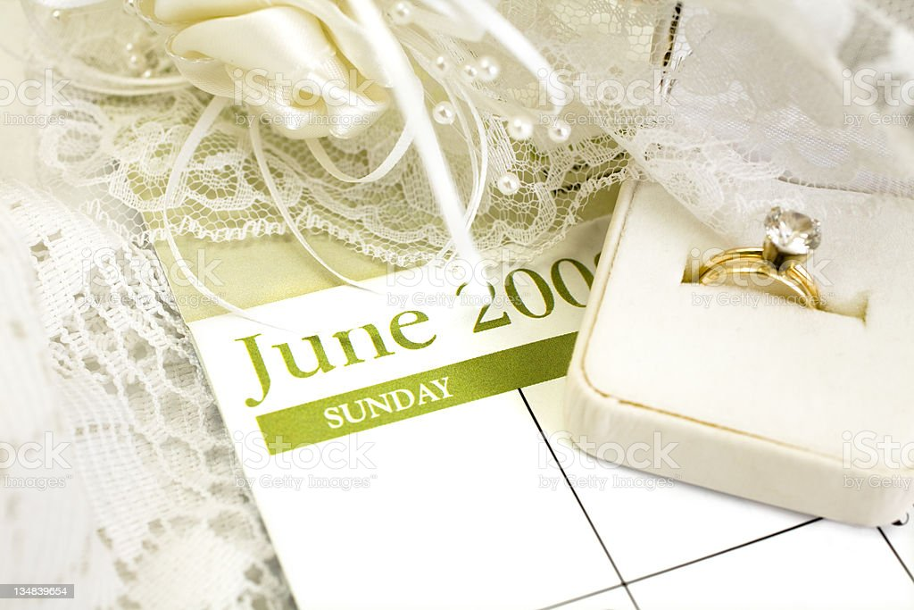 Calendar showing month of June with rings and lace royalty-free stock photo