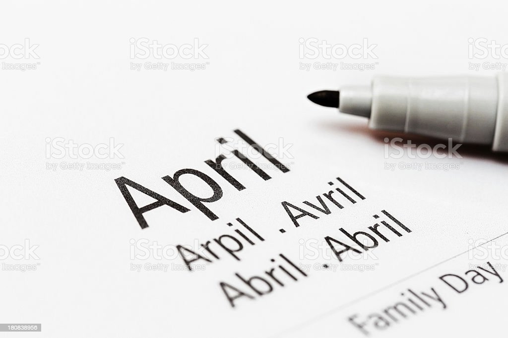 Calendar shows the month of April in many languages stock photo