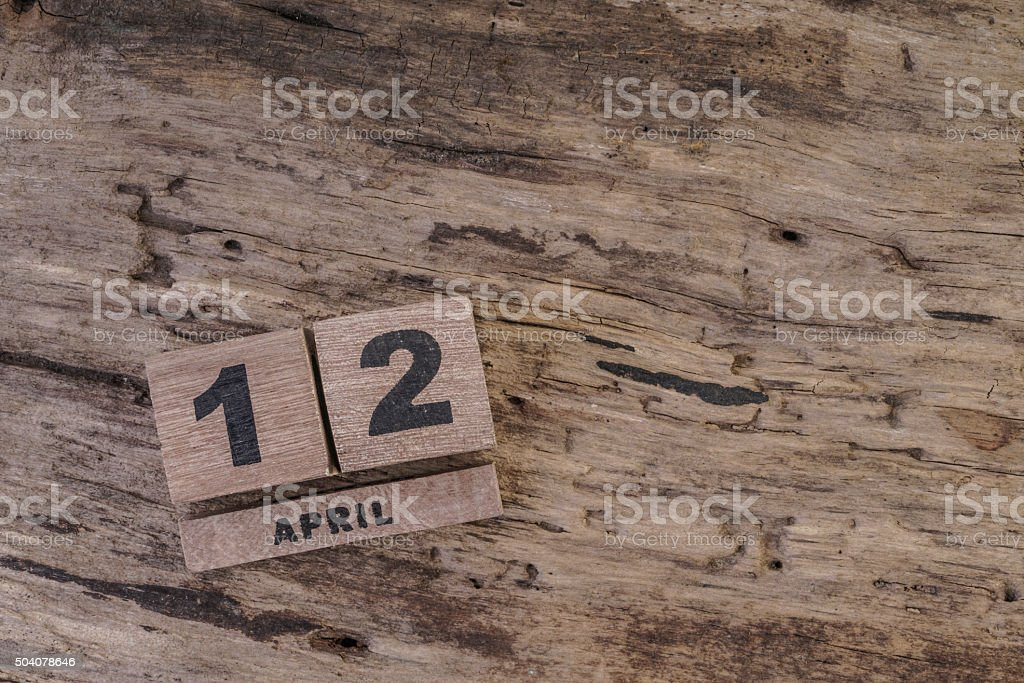 calendar template with wooden cubes for april on wooden background stock photo
