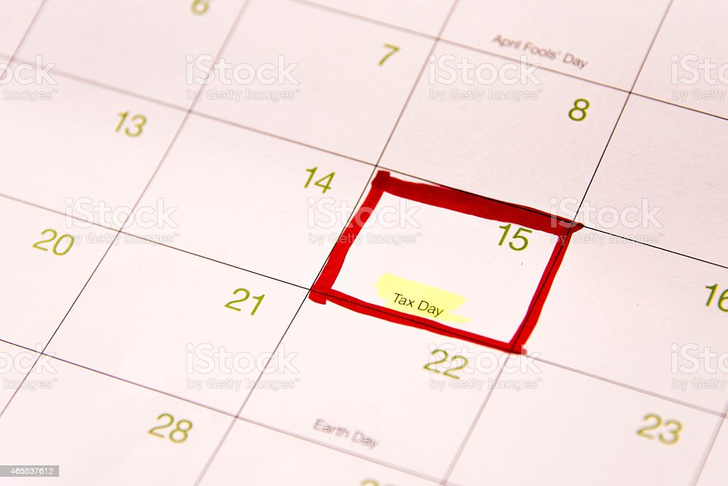 Calendar with a red box around April 15th stock photo
