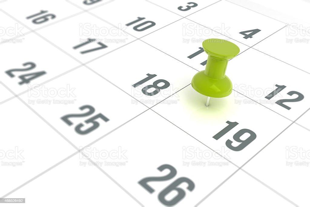 Calendar with green pushpin to mark reminder stock photo
