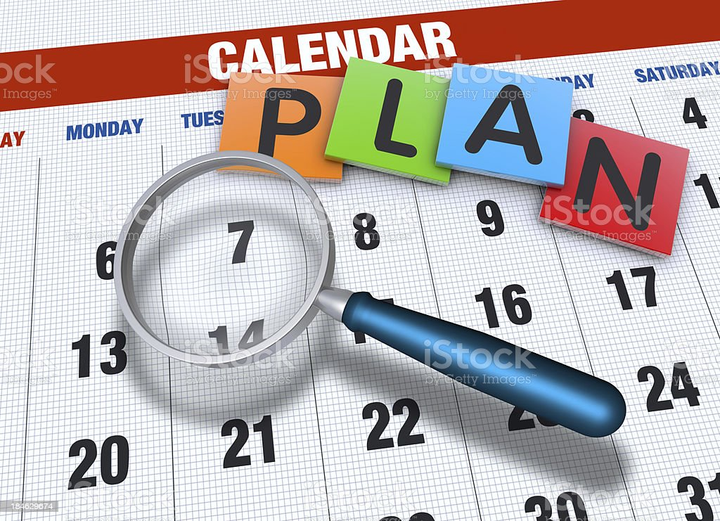 Calendar with magnifying glass stock photo