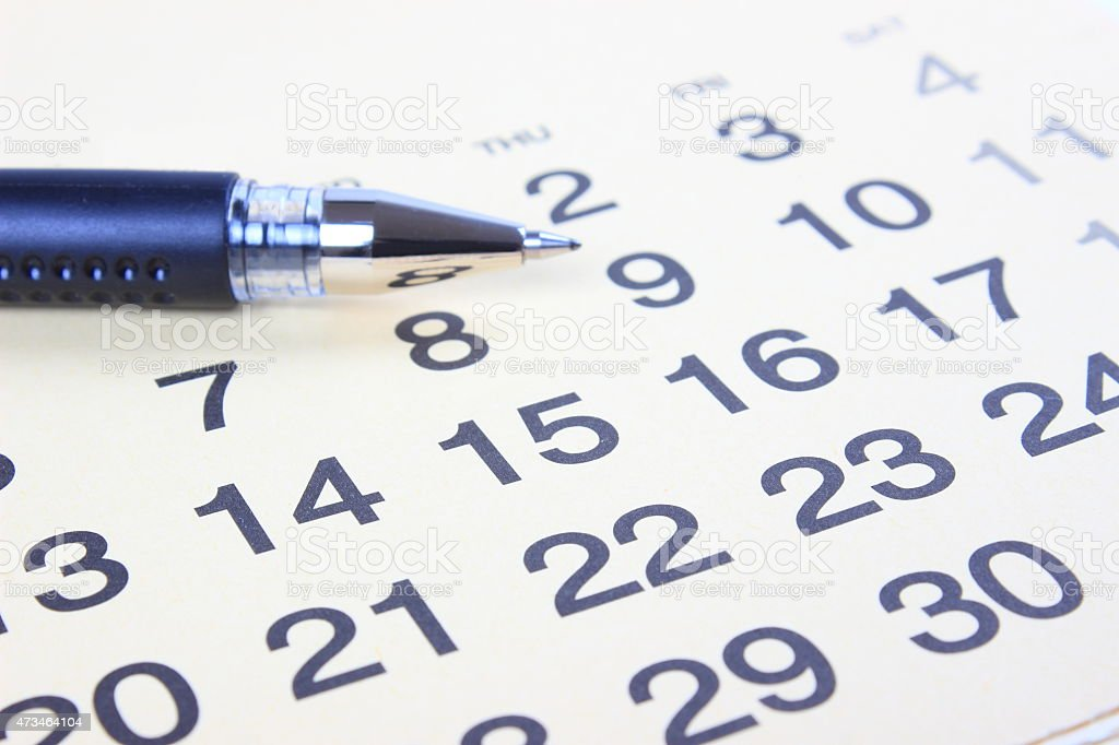 Calendar with pen stock photo