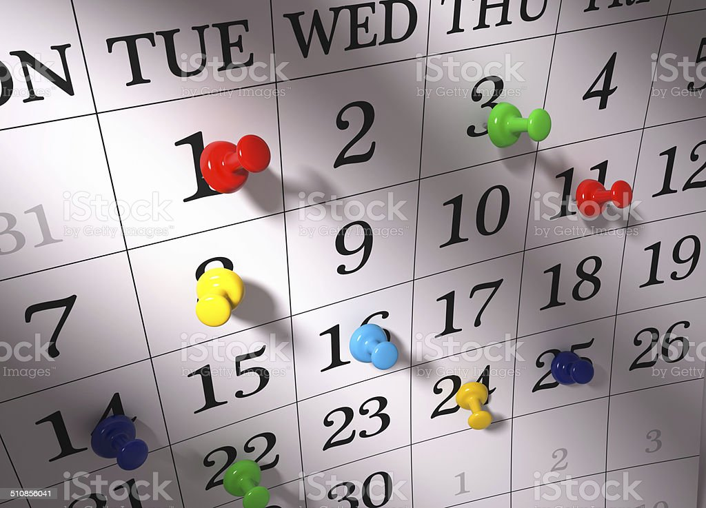 Calendar with pushpins stock photo