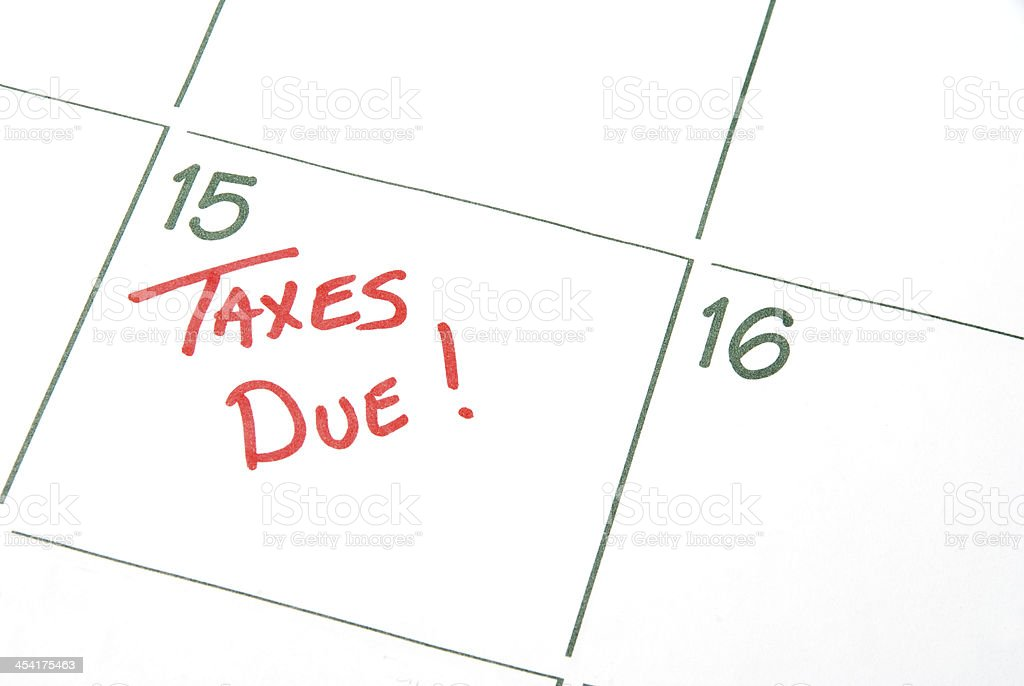 Calendar with taxes due written in red stock photo